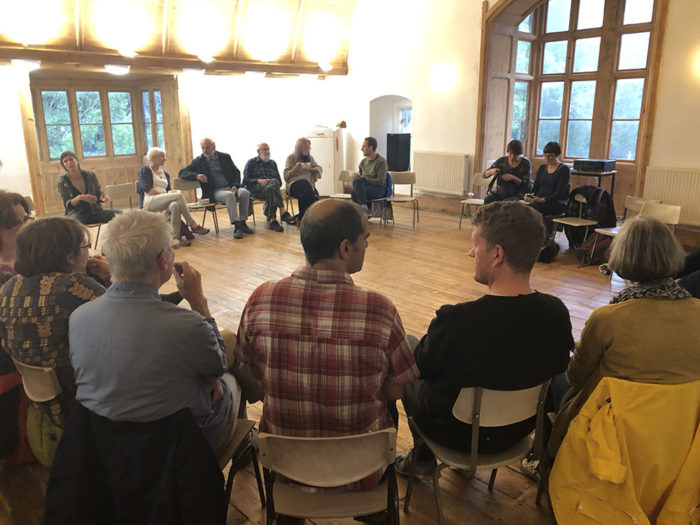 XR Stroud meeting with people sat in a circle in the convent room.