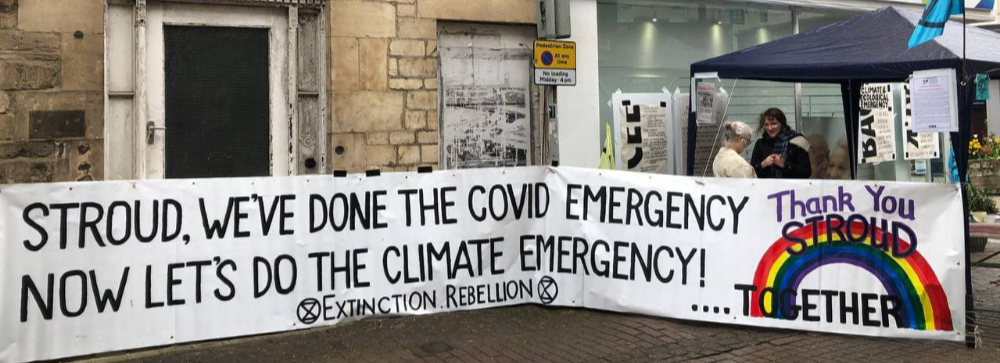 """A banner that says """"Stroud we've done the covid emergency, now let's do the climate emergency."""